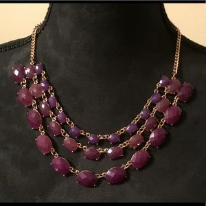 Beautiful purple and gold tone necklace.